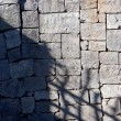 Deep shadows on a tiled stone wall — Stock Photo #6240486