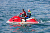 Young couple on board a large jetbike — Stock Photo