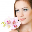 Beautiful woman with orchid — Stock Photo #5606678