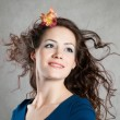 Woman with fly-away hair — Stockfoto