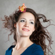 Woman with fly-away hair - Stok fotoğraf