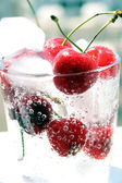 Cherries fruit in glass with ice — Stock Photo