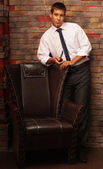 The man next to the chair. — Stock Photo
