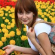 Girl and flowers. — Stock Photo