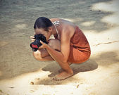 Woman and camera — Stockfoto