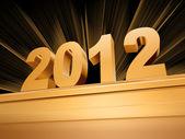 золотой 2012 на пьедестал — Стоковое фото