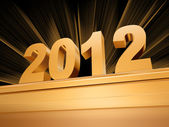 Golden 2012 on a pedestal — Stock Photo