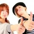 Thumps up girls — Stock Photo