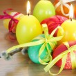 Easter Festive Painted Eggs and Candles - Stockfoto