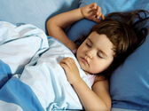 Little Girl Sleeping in Her Bed — Stock Photo