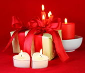 Romantic Gifts and Burning Candles — Stock Photo