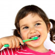 Stock Photo: Little Girl Brushing Teeth