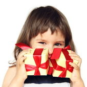 Happy Girl Holding Gifts in Hands — Stock Photo