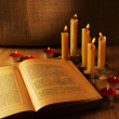 Open Old Book and Burning Candles — Stock Photo