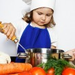 Young Girl in Cook's Cap Preparing Food — Stock Photo