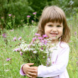 Stock Photo: Smiling Girl with Bunch of Flowers