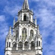 The clock of the city hall at Marienplatz in Munich - Stock Photo