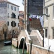 Stock Photo: Buildings on a canal in Venice