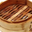 Chinese steamed dimsum in bamboo containers traditional cuisine — Stock Photo
