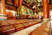 Rows of seats in chinese temple — Stock Photo