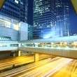 Traffic in downtown at night — Stock Photo
