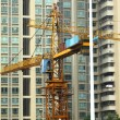 Building of a skyscraper with two tower cranes — Stock Photo #5594969