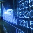 Stock ticker board at the stock exchange - Stock Photo