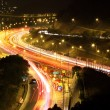 Road with car traffic at night and blurry lights showing speed a — Stock Photo
