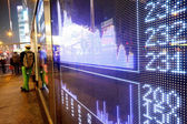 Stock ticker board at the stock exchange — Stock Photo