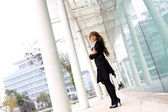 Pretty asian business woman at office building — Stock Photo