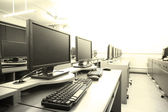 Workplace room with computers in row — Stock Photo