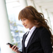 Beautiful business woman on the phone at modern building — Stock Photo