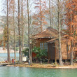 Wood house on water — Stock Photo