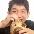 Stock Photo: Asia man with piggy bank