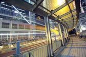 Traffic night and footbridge in hongkong — Stock Photo
