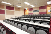 Empty hall for presentation with grey armchairs — Stock Photo