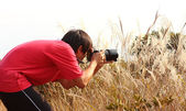 Photographer taking photo in country side — Stock Photo