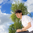 Asia man relax in the park in the city — Stock Photo