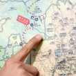 Royalty-Free Stock Photo: Close up of a hand pointing out location on the map.