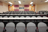 Sala vacía para presentación con sillones gris — Foto de Stock