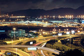 Freeway in night with cars light in modern city. — Stock Photo