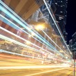 Traffic in finance urban at night — Stock Photo