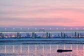 Sunset in hongkong and highway bridge and container pier — Stock Photo