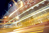 Traffic in finance urban at night — Foto Stock