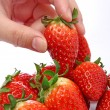 Takeing stawberry — Stock Photo
