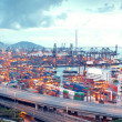 图库照片: Container terminal and stonecutter bridge in Hong Kong