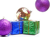 Beautiful gifts with gold bows and Christmas ball — Stock Photo