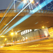 Traffic light trails in the street by modern building — Stock Photo