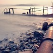Old metal pipe and road to sea — Stock Photo #6739436