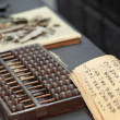 Abacus and book on the table in a chinese old shop — Stock Photo